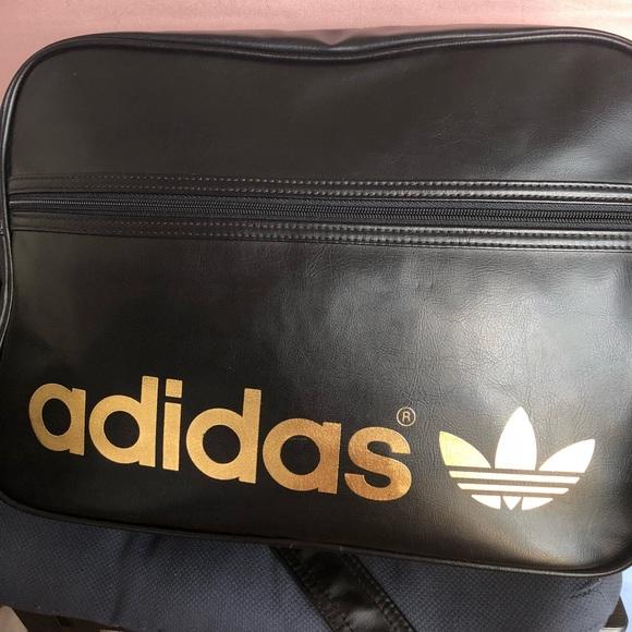 8004211f1a7 adidas Handbags - ADIDAS black gold crossbody bag